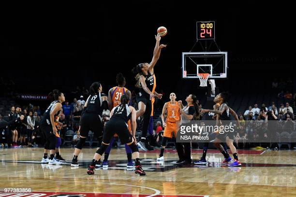 A'ja Wilson of the Las Vegas Aces and Brittney Griner of the Phoenix Mercury tipoff at the start of the game on June 17 2018 at the Mandalay Bay...