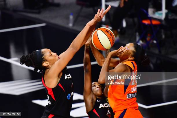 A'ja Wilson of the Las Vegas Aces blocks a shot by DeWanna Bonner of the Connecticut Sun during the second half of Game 2 of their Third Round...