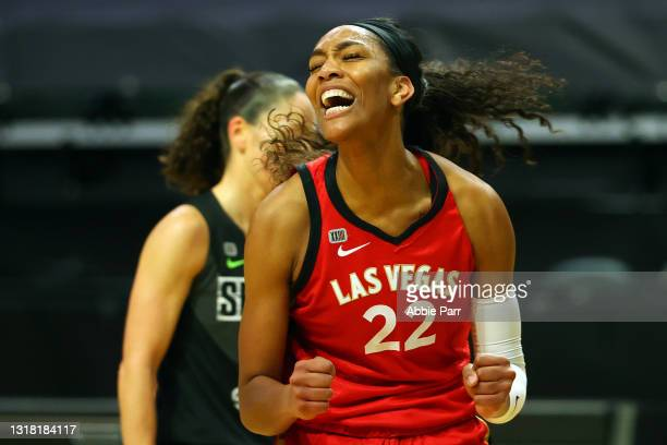 Ja Wilson of the Las Vegas Aces celebrates after making a basket while being fouled during the first quarter against the Seattle Storm at Angel of...