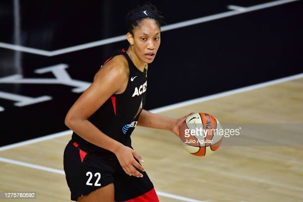 A'ja Wilson of the Las Vegas Aces dribbles during the second half against the Connecticut Sun in Game 2 of their Third Round playoffs at Feld...