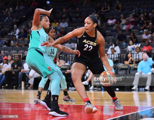 A'ja Wilson of the Las Vegas Aces drives against Marissa Coleman of the New York Liberty during their game at the Mandalay Bay Events Center on...