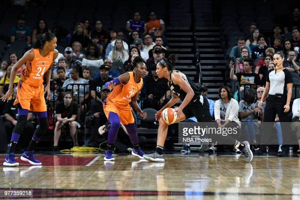 A'ja Wilson of the Las Vegas Aces drives against Sancho Lyttle of the Phoenix Mercury on June 17 2018 at the Mandalay Bay Events Center in Las Vegas...