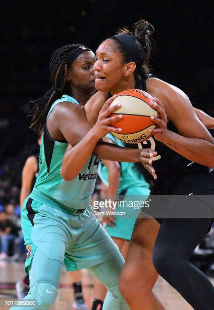 A'ja Wilson of the Las Vegas Aces drives against Sugar Rodgers of the New York Liberty during their game at the Mandalay Bay Events Center on August...