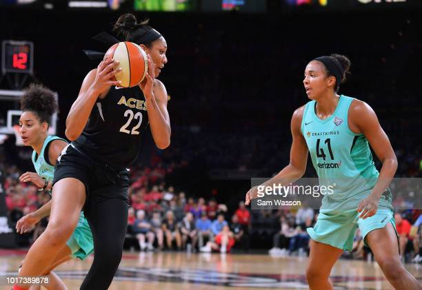 A'ja Wilson of the Las Vegas Aces looks to drive against Kiah Stokes of the New York Liberty during their game at the Mandalay Bay Events Center on...