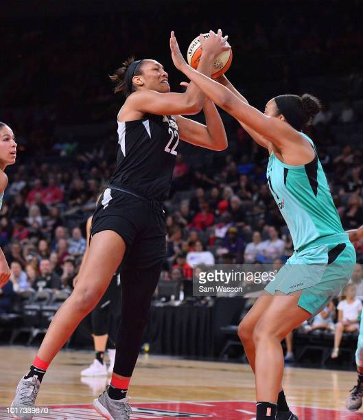A'ja Wilson of the Las Vegas Aces shoots against Kiah Stokes of the New York Liberty during their game at the Mandalay Bay Events Center on August 15...