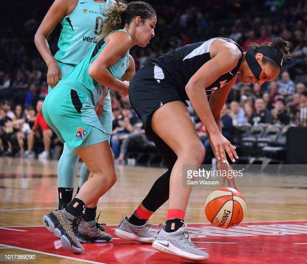 A'ja Wilson of the Las Vegas Aces tries to grab a loose ball against Kia Nurse of the New York Liberty during their game at the Mandalay Bay Events...