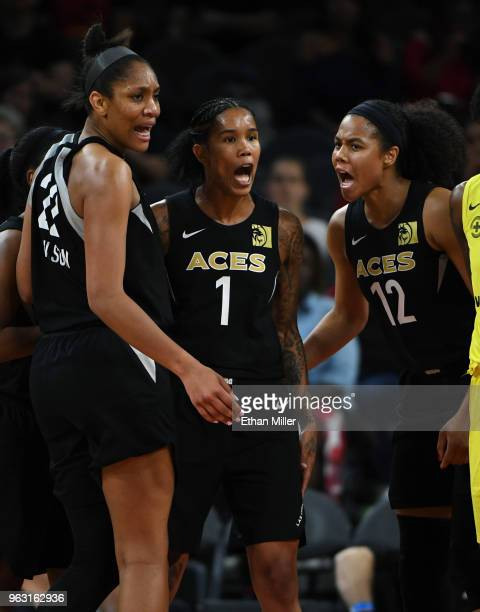A'ja Wilson Tamera Young and Nia Coffey of the Las Vegas Aces react after Young was fouled by a Seattle Storm player during the Aces' inaugural...