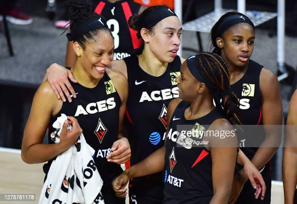A'ja Wilson walks across the court with Dearica Hamby Jackie Young and Sugar Rodgers after defeating the Connecticut Sun 8375 following Game 2 of...