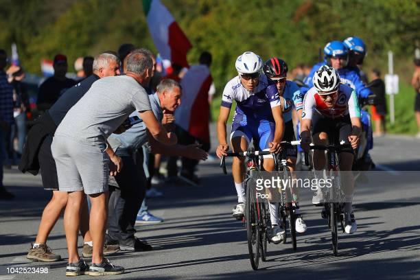 Jaakko Hanninen of Finland / Marc Hirschi of Switzerland / Bjorg Lambrecht of Belgium / Fans / Public / during the Men Under 23 Road Race a 1799km...