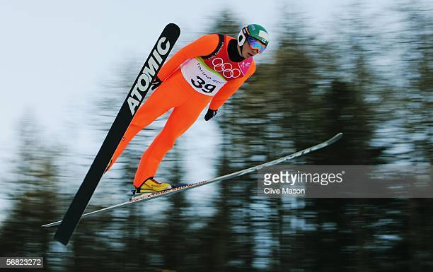 Jaakko Tallus of Finland completes jump 1 in the Nordic Combined Normal Hill event on Day 1 of the 2006 Turin Winter Olympic Games on February 11...