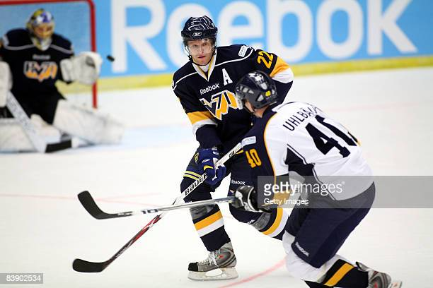 Jaakko Uhlback and David Petrasek fights for the puck during the IIHF Champions Hockey League match between HV 71 Joenkoeping and Espoo Blues on...
