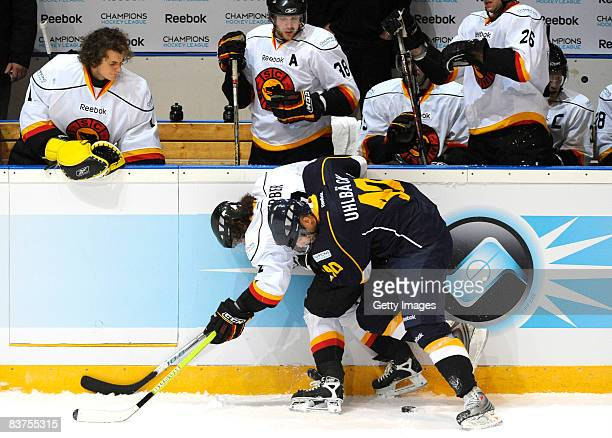 Jaakko Uhlback of Espoo Blues and Beat Gerber of SC Bern fight for the puck during the IIHF Champions Hockey League match between Espoo Blues and SC...