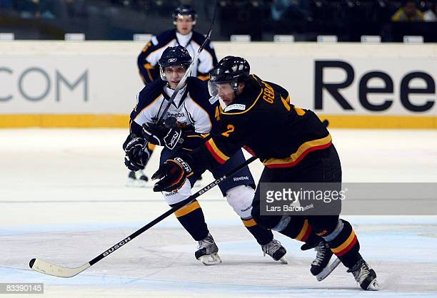 Jaakko Uhlback of Espoo in action with Beat Gerber of Bern during the IIHF Champions Hockey League match between SC Bern and Espoo Blues at the...