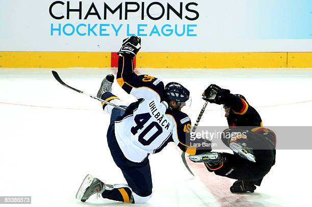 Jaakko Uhlback of Espoo in action with Pascal Berger of Bern during the IIHF Champions Hockey League match between SC Bern and Espoo Blues at the...
