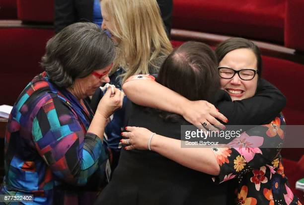 Jaala Pulford is congratulated by Harriet Shing MP and Fiona Patten MP as the bill passes inside of the Parliament of Victoria after the Upper House...
