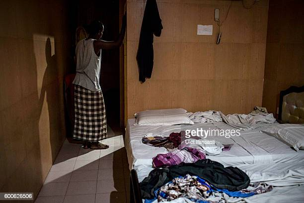 Jaalle a Somalia asylum seeker is seen inside his room in the Kolekta hotel where hundreds of refugees and asylum seekers stay for years while...