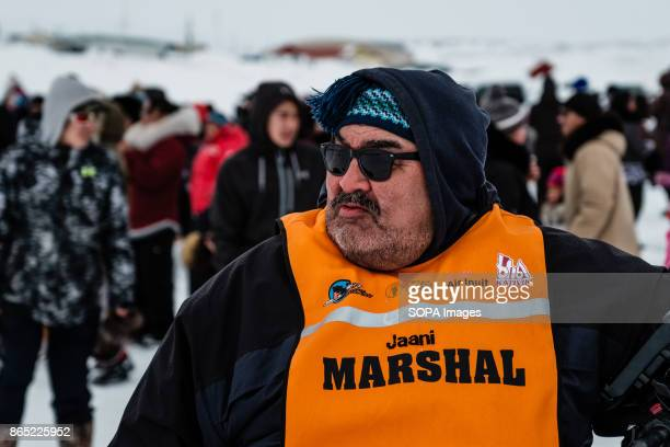 BAY INUKJUAK NUNAVIK QUEBEC CANADA Jaani of the security team watching the arrival of the dogs sleds in Inukjuak Since 2001 Ivakkak has been an event...