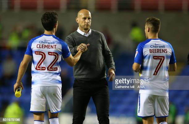 Jaap Stam manager of Reading shakes hands with Pelle Clement and Roy Beerens of Reading after the Sky Bet Championship match between Reading and...