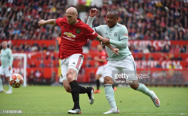 Jaap Stam of Manchester United and Paulo Sergio of Fc Bayern Legend in action during the Manchester United '99 Legends and FC Bayern Legends at Old...
