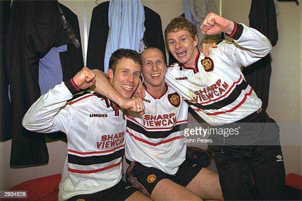 Jaap Stam Ole Gunnar Solskjaer and Ronny Johnson of Manchester United celebrate in the dressing room after the FA Cup semifinal between Arsenal v...