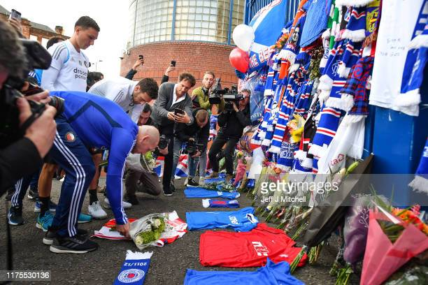 Jaap Stam the head coach of Feyenoord joins Rangers fans as they leave tributes at the gates of Ibrox Stadium for former player Fernando Ricksen who...