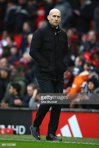 Jaap Stam the manager of Reading looks dejected at half time during the Emirates FA Cup third round match between Manchester United and Reading at...