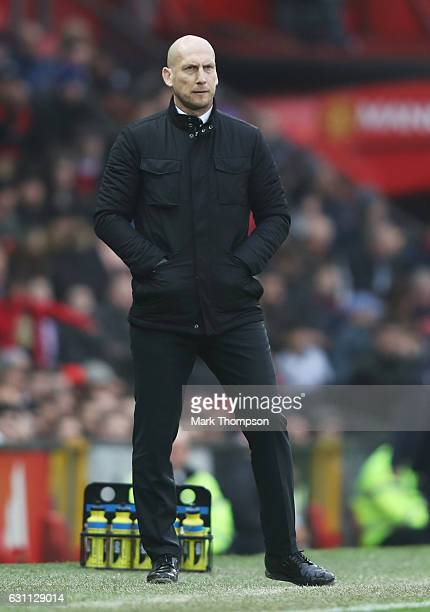 Jaap Stam the manager of Reading looks on during the Emirates FA Cup third round match between Manchester United and Reading at Old Trafford on...