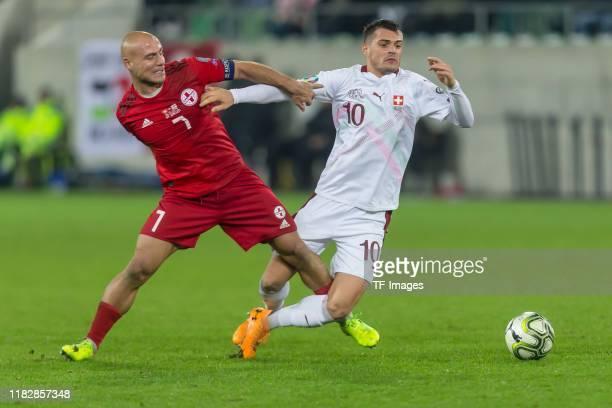 Jaba Kankava of Georgia and Granit Xhaka of Switzerland battle for the ball during the UEFA Euro 2020 Qualifier between Switzerland and Georgia on...