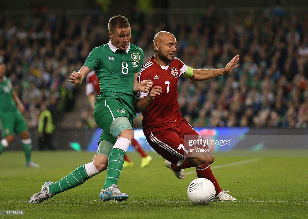 Jaba Kankava of Georgia battles with James McCarthy of the Republic of Ireland during the UEFA EURO 2016 Group D qualifying match between Republic of Ireland and Georgia at Aviva Stadium on September 7, 2015 in Dublin, Ireland.