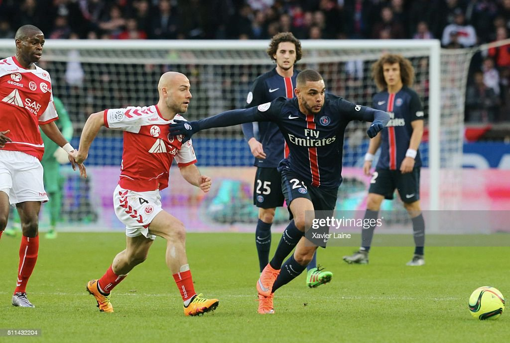 Jaba Kankava of Stade de Reims in action with Layvin Kurzawa of Paris Saint-Germain during the French Ligue 1 between Paris Saint-Germain and Stade de Reims at Parc Des Princes on february 20, 2016 in Paris, France.