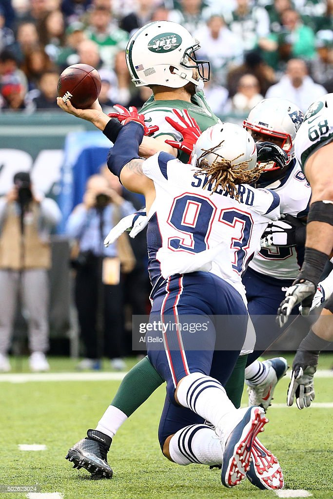 Jabaal Sheard #93 of the New England Patriots sacks Ryan Fitzpatrick #14 of the New York Jets to fumble the ball in the third quarter during their game at MetLife Stadium on December 27, 2015 in East Rutherford, New Jersey.