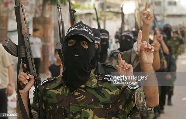 Militants from AlAqsa Martyrs Brigades the armed wing of the Fatah movement parade in the streets of the northern Gaza Strip refugee camp of Jabalia...