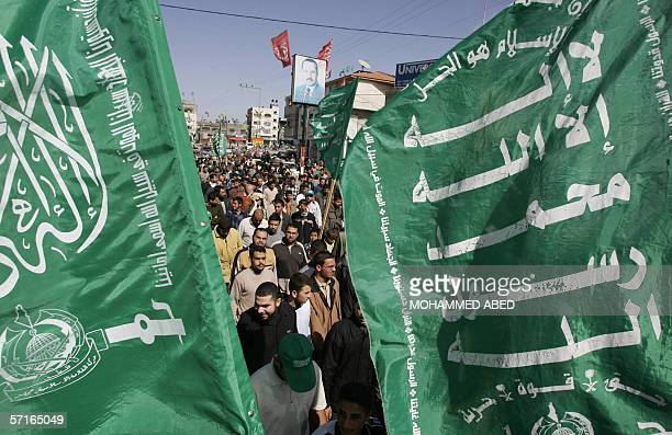 Green party flags flutter as Hamas supporters protest during