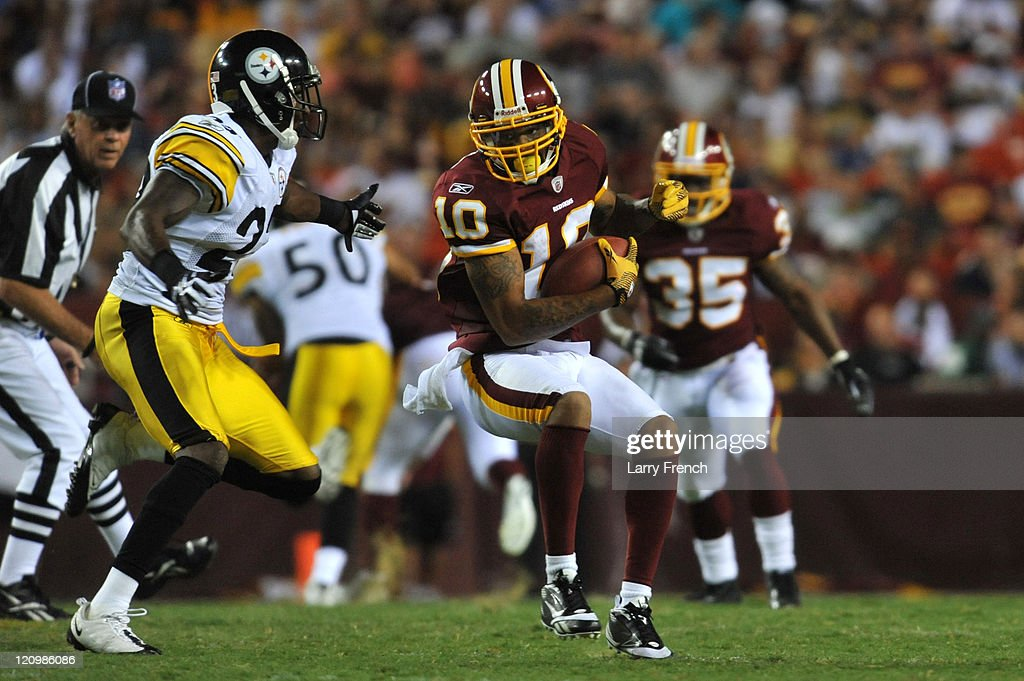 Jabar Gaffney #10 of the Washington Redskins runs the ball against the Pittsburgh Steelers at FedExField on August 12, 2011 in Landover, Maryland. The Redskins defeated the Steelers 16-7.