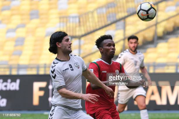 Jabar Sharza of Afghanistan challenges Mahmood Mabrook Nasib Al Mushaifri of Oman during the Airmarine Cup match between Oman and Afghanistan at...