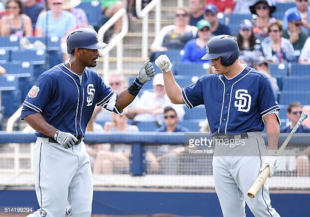 Jabari Blash is congratulated by teammate Hunter Renfroe after hitting a second inning home run against the Milwaukee Brewers during a spring...