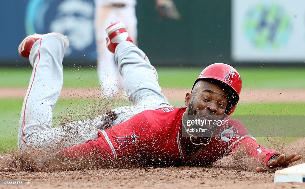Jabari Blash #54 of the Los Angeles Angels of Anaheim is thrown out at first in the ninth inning against the Seattle Mariners during their game at Safeco Field on June 13, 2018 in Seattle, Washington.