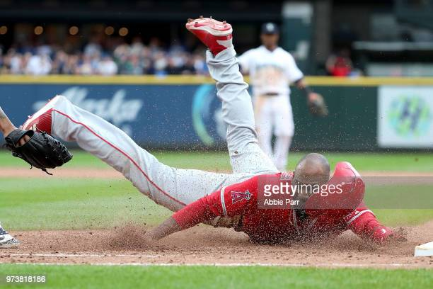 Jabari Blash of the Los Angeles Angels of Anaheim is thrown out at first in the ninth inning against the Seattle Mariners during their game at Safeco...