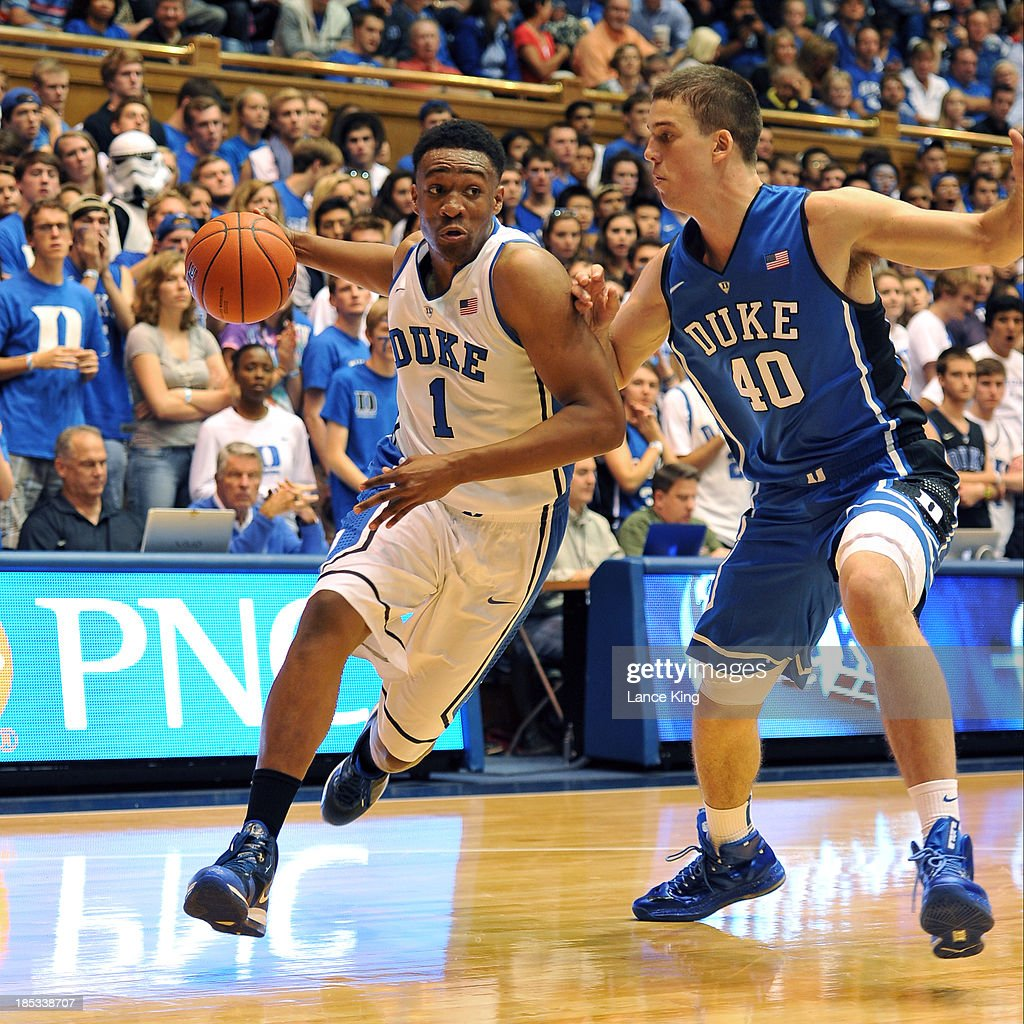 Jabari Parker #1 dribbles against Marshall Plumlee #40 of the Duke Blue Devils during Countdown to Craziness at Cameron Indoor Stadium on October 18, 2013 in Durham, North Carolina.