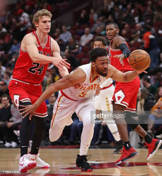 Jabari Parker of the Atlanta Hawks drives past Lauri Markkanen of the Chicago Bulls at the United Center on December 11 2019 in Chicago Illinois NOTE...