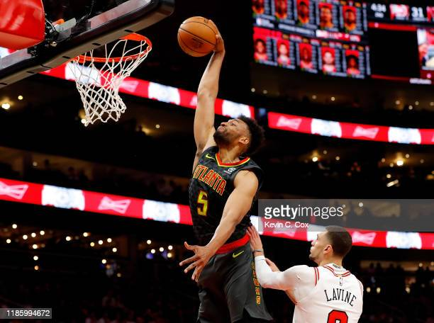 Jabari Parker of the Atlanta Hawks dunks against Zach LaVine of the Chicago Bulls in the first half at State Farm Arena on November 06 2019 in...
