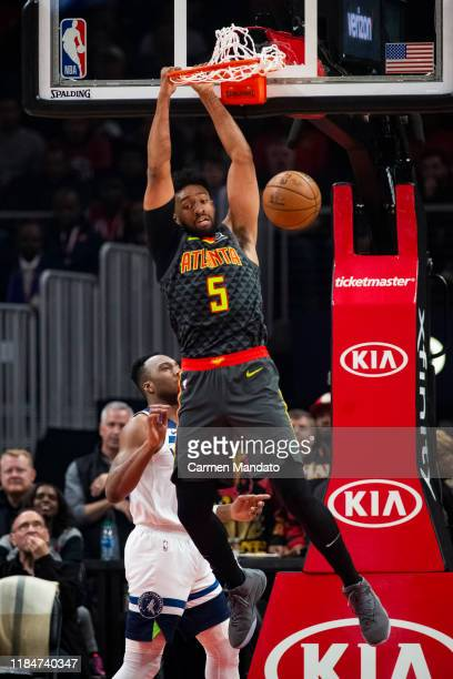 Jabari Parker of the Atlanta Hawks dunks the ball during the first quarter of the game against the Minnesota Timberwolves at State Farm Arena on...