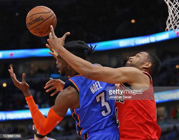 Jabari Parker of the Chicago Bulls battles for a rebound with Nerlens Noel of the Oklahoma City Thunder at the United Center on December 07 2018 in...