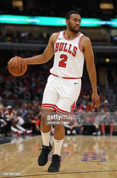 Jabari Parker of the Chicago Bulls brings the ball up the court against the Indiana Pacers during a preseason game at the United Center on October 10...