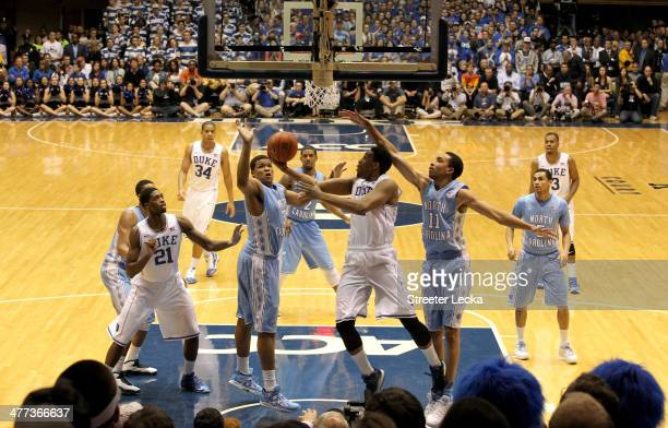 Jabari Parker of the Duke Blue Devils drives to the basket against Brice Johnson of the North Carolina Tar Heels during their game at Cameron Indoor...