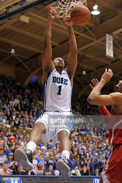 Jabari Parker of the Duke Blue Devils dunks against the North Carolina State Wolfpack at Cameron Indoor Stadium on January 18 2014 in Durham North...