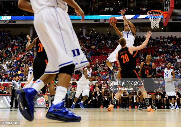Jabari Parker of the Duke Blue Devils goes up for a shot against Jakob Gollon of the Mercer Bears in the first half in the second round of the 2014...