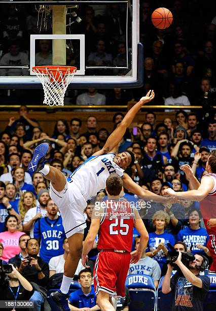 Jabari Parker of the Duke Blue Devils is fouled on a drive to the basket by Drgan Sekelja of the Florida Atlantic Owls during play at Cameron Indoor...