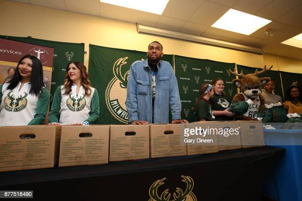Jabari Parker of the Milwaukee Bucks and Bucks legend Michael Redd along with mascot Bango and members of the Milwaukee Bucks Dancers interact with...