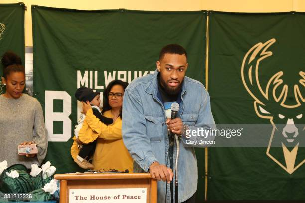 Jabari Parker of the Milwaukee Bucks and Bucks legend Michael Redd along with mascot Bango interact with local families and assist volunteers with...